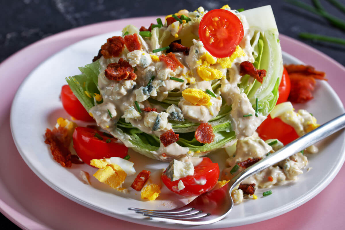 Father's Day Menu - Classic Wedge Salad with bacon, tomato, egg, blue cheese, and dressing