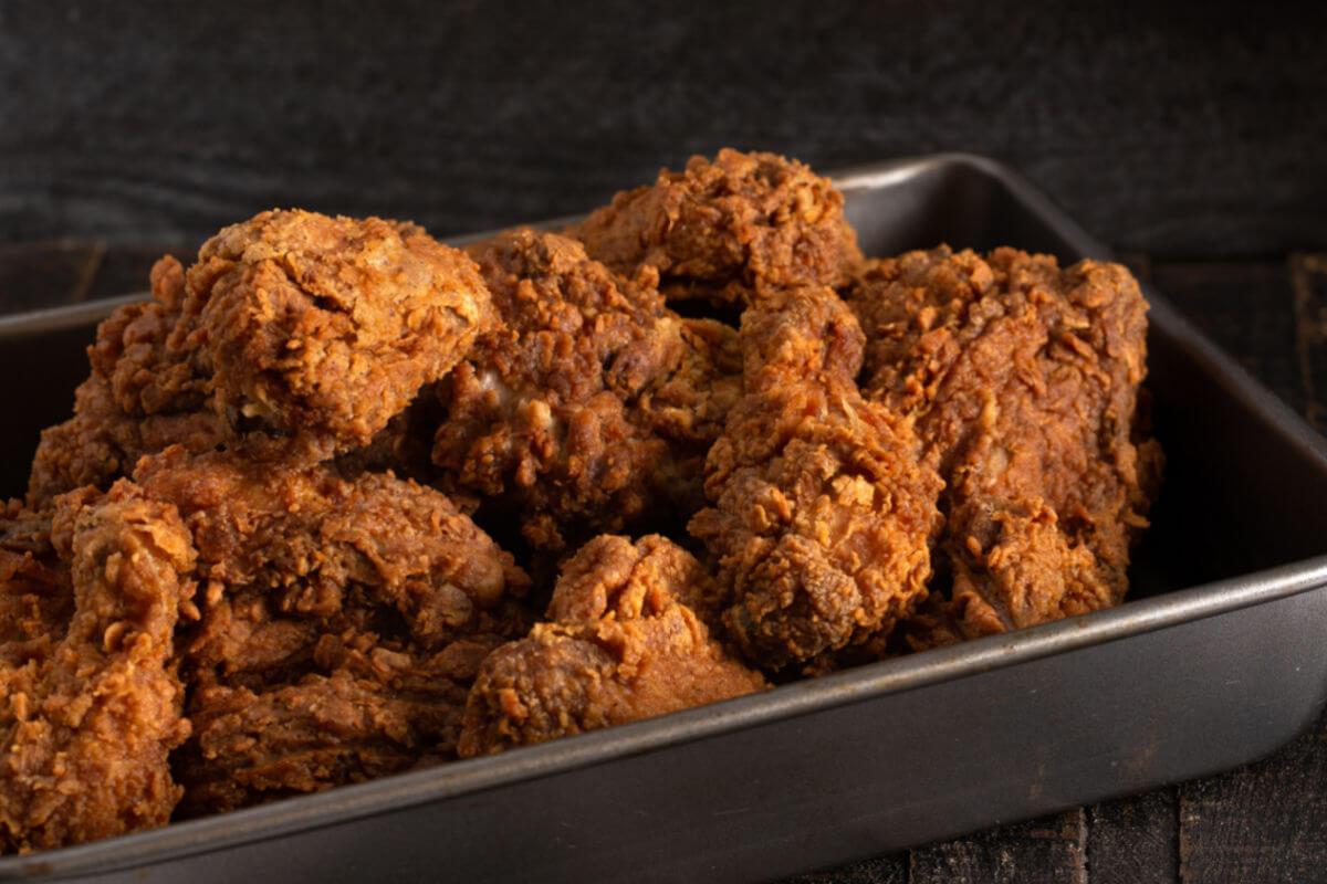 A tin of Extra Crispy Bourbon Fried Chicken