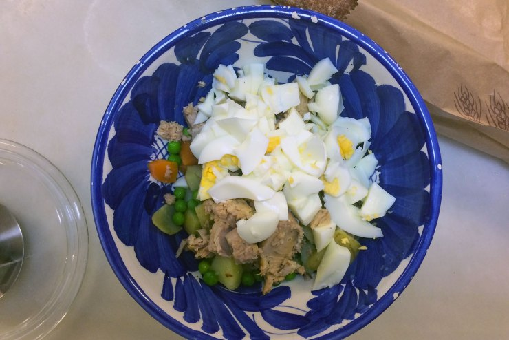 Eggs and tuna added to ensalada rusa recipe.