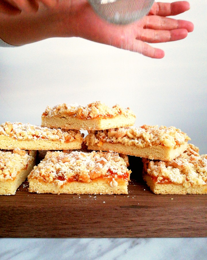 apricot jam bars dusting with powdered sugar