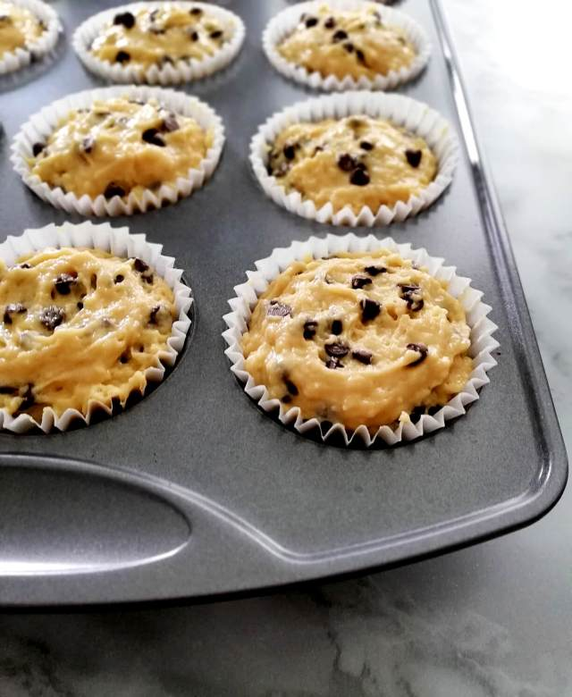 chocolate chip muffins batter scooped into muffin tin 3_4 view