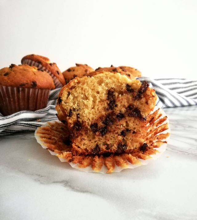 chocolate chip muffins inside texture head on view with more muffins in the back