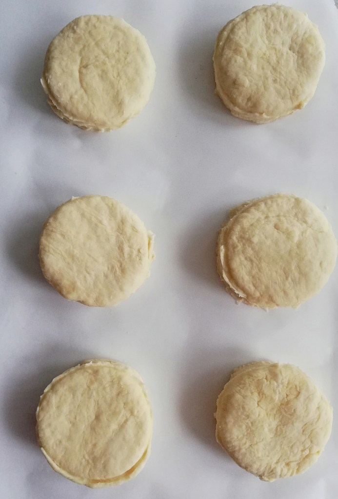 biscuits arranged on baking sheet