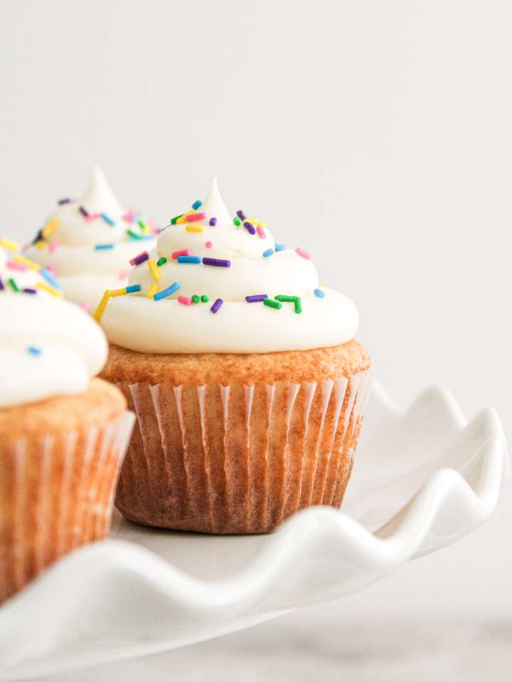 easy vanilla cupcakes on cake stand close up