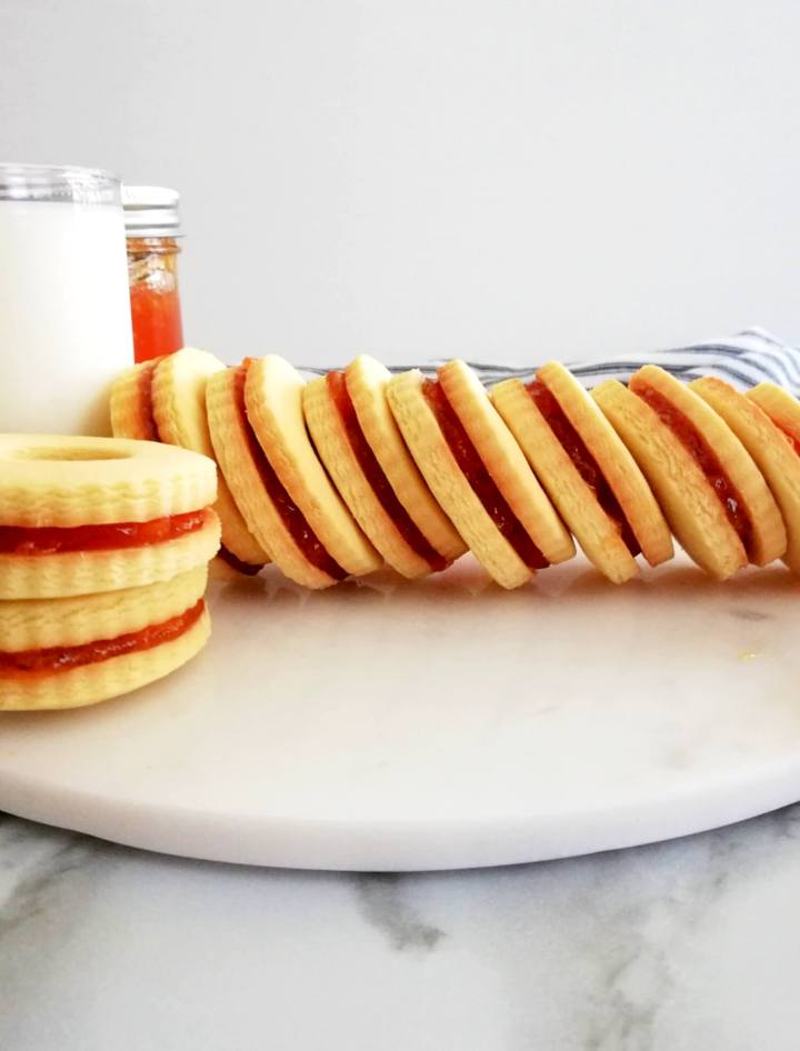 apricot jam filled sandwich cookies lined up sideways