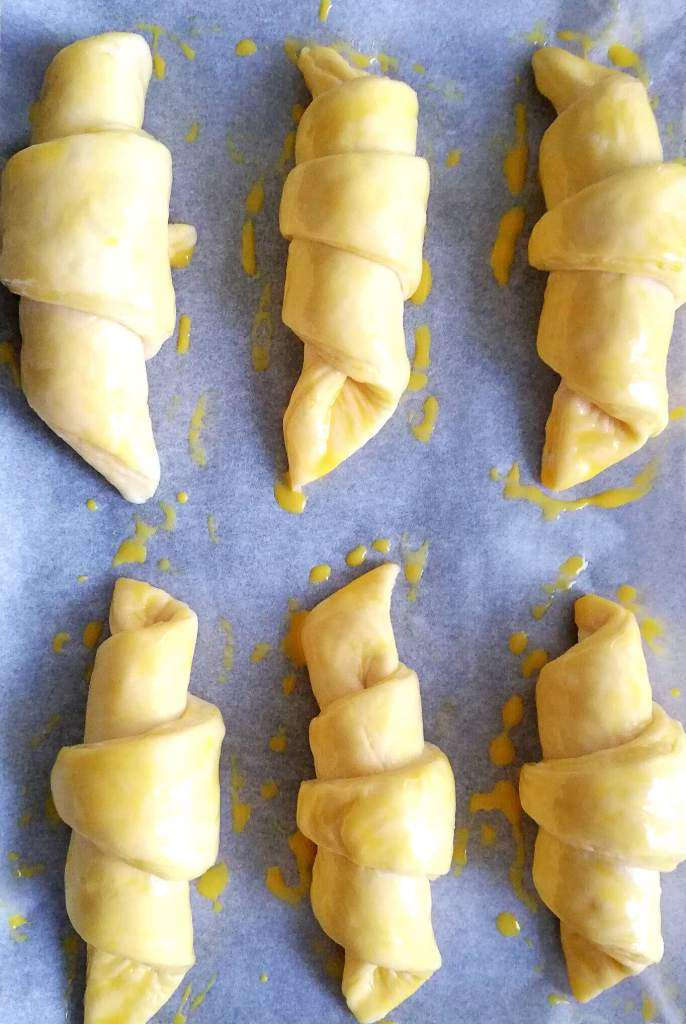 croissants shaped, risen, and egg washed