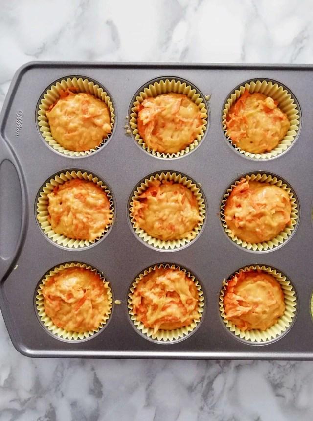 carrot muffin batter in muffin tin