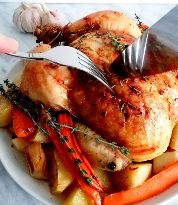 herb roasted chicken with potatoes and carrots carving chicken