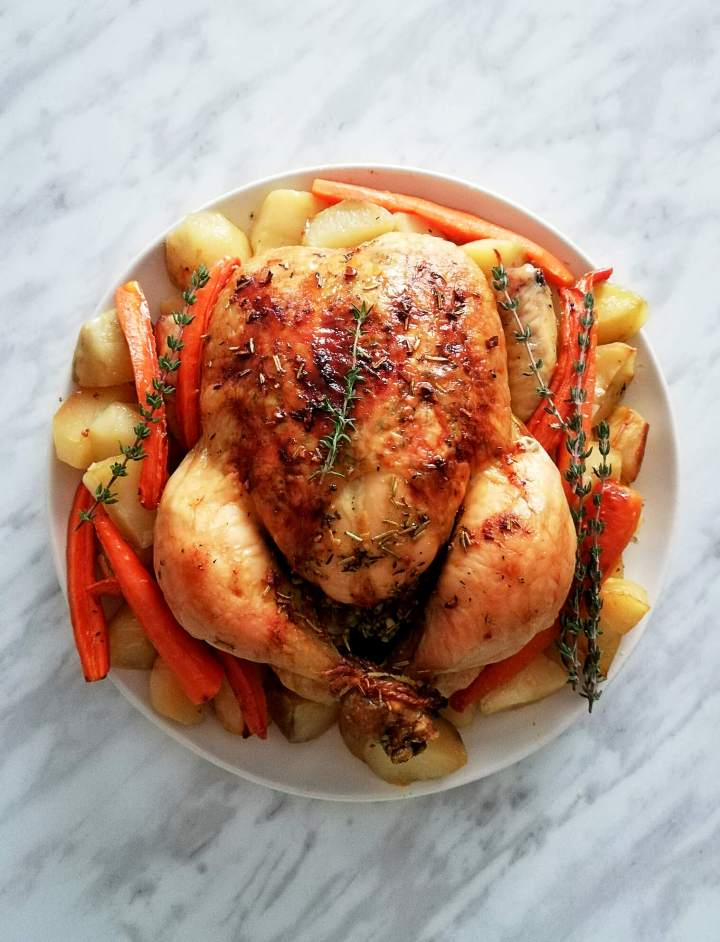 herb roasted chicken with potatoes and carrots plated