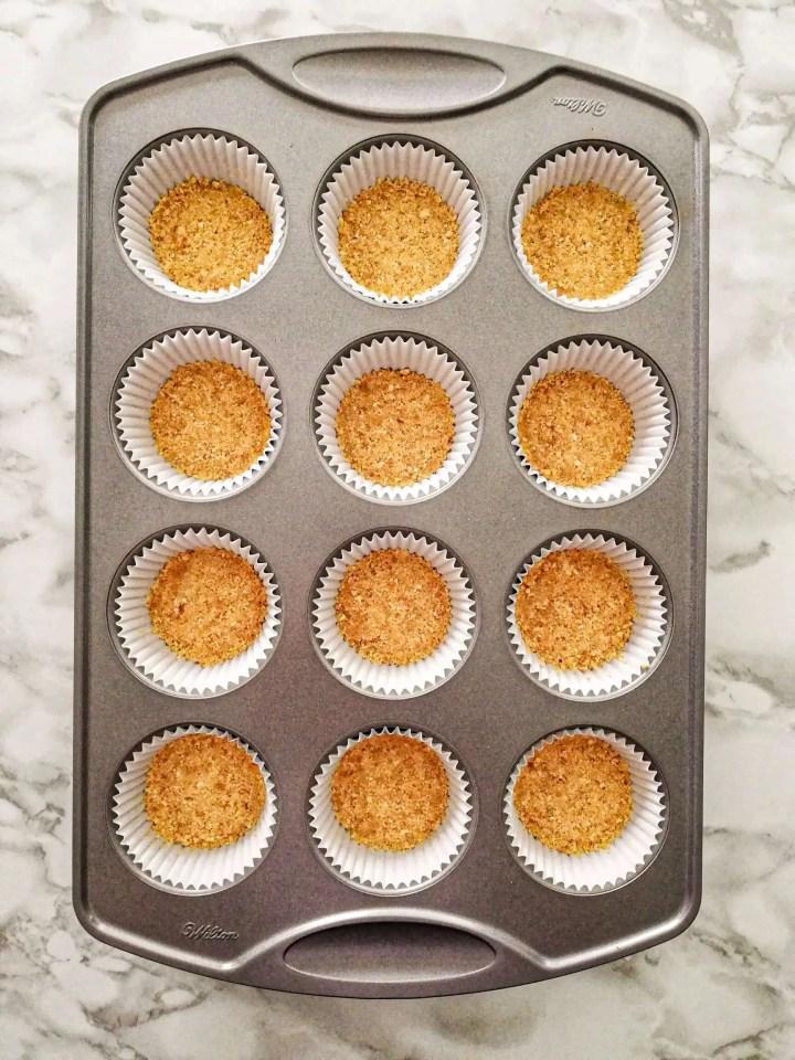 mini cheesecakes crust in muffin tin