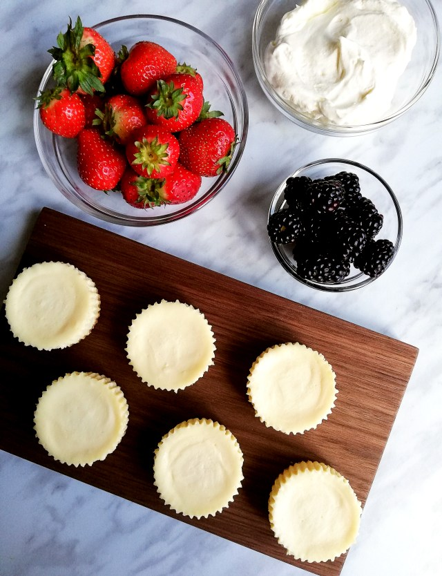 mini cheesecakes with toppings overhead