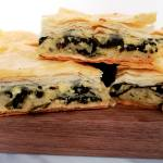 spanakopita on serving board side view