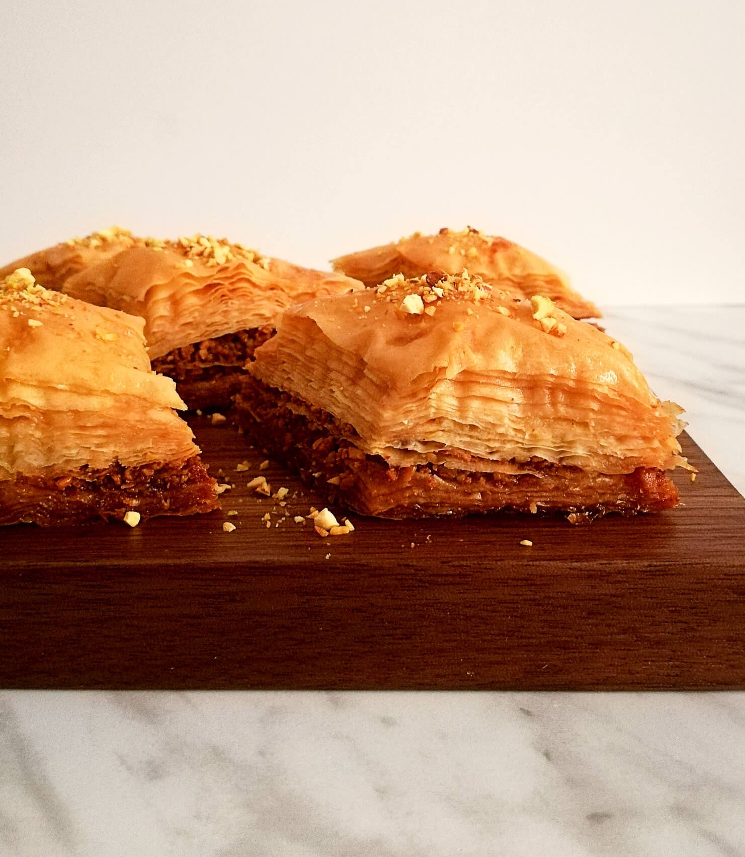 baklava on serving board side view close up