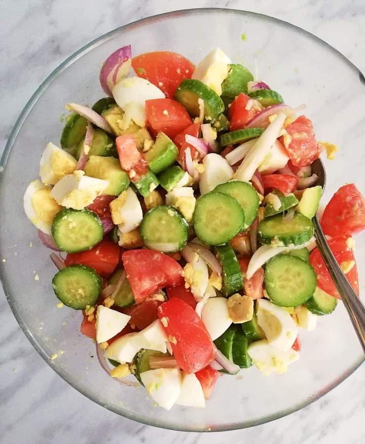 egg and avocado salad tossed together