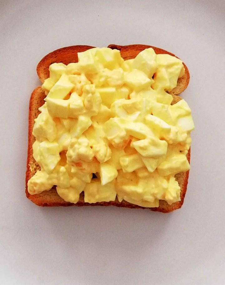 egg salad sandwich egg salad on top of toasted toast