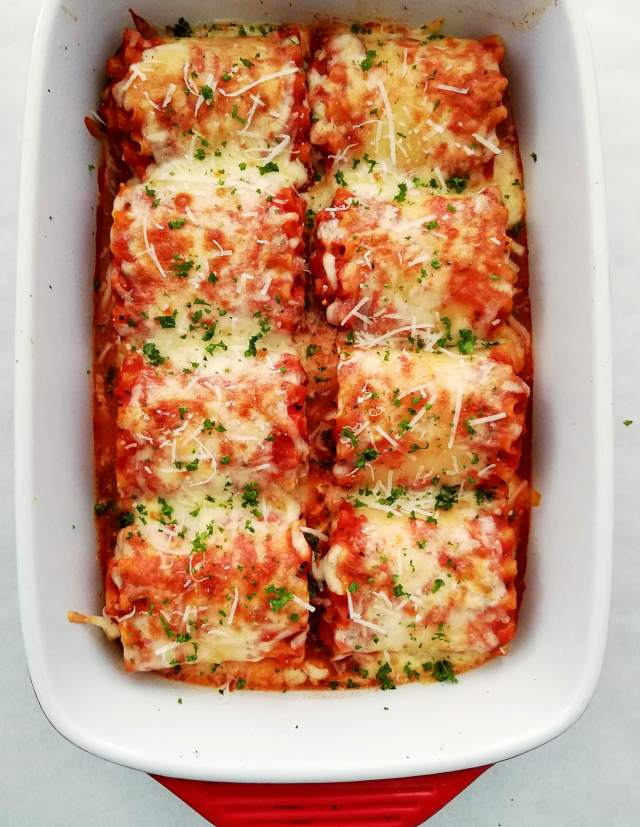 lasagna rolls baked and topped with parsley overhead