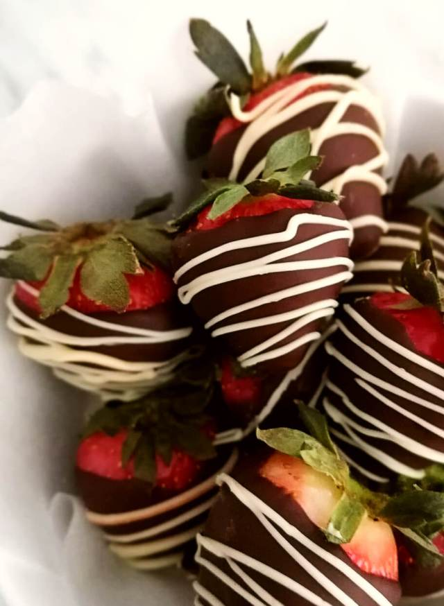 chocolate covered strawberries in bowl closeup