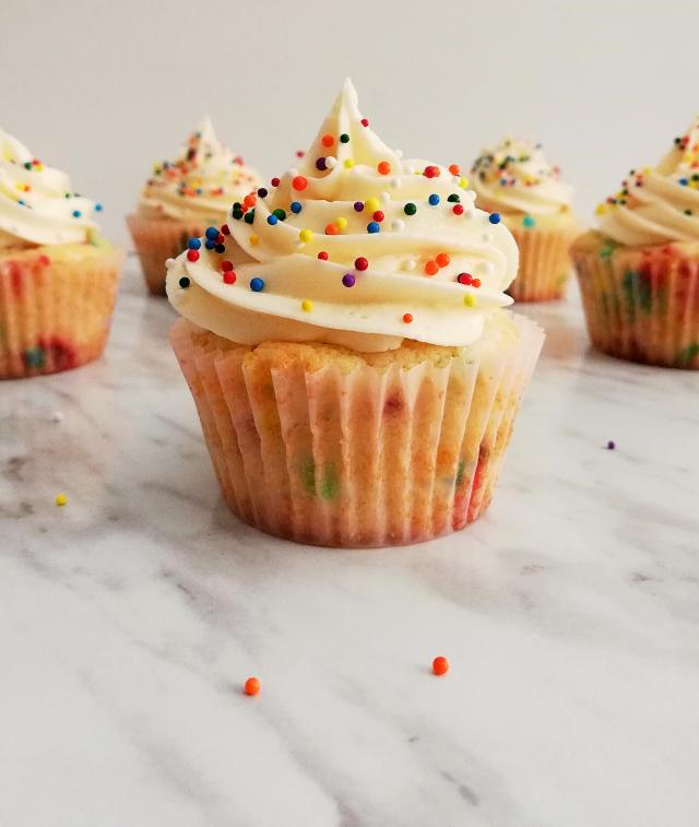 funfetti cupcakes frosted and topped with sprinkles