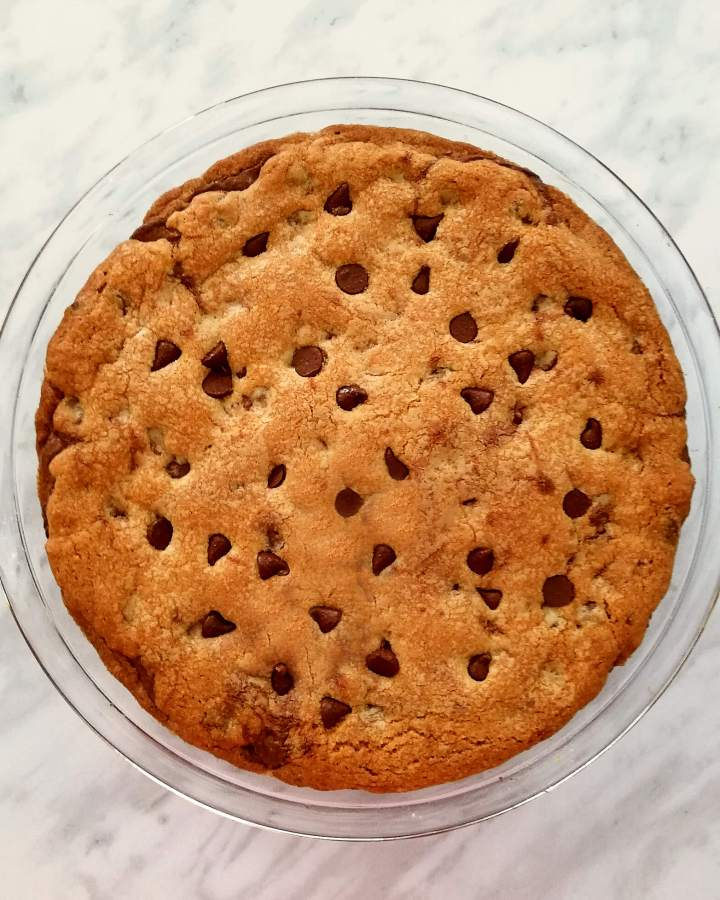 giant Nutella stuffed chocolate chip cookie in pie dish overhead
