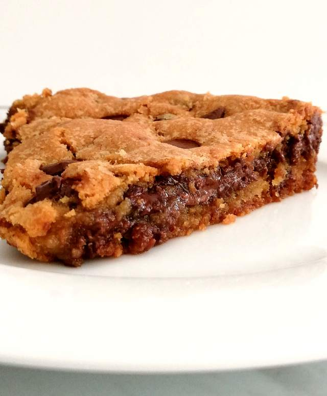 giant Nutella stuffed chocolate chip cookie slice close up