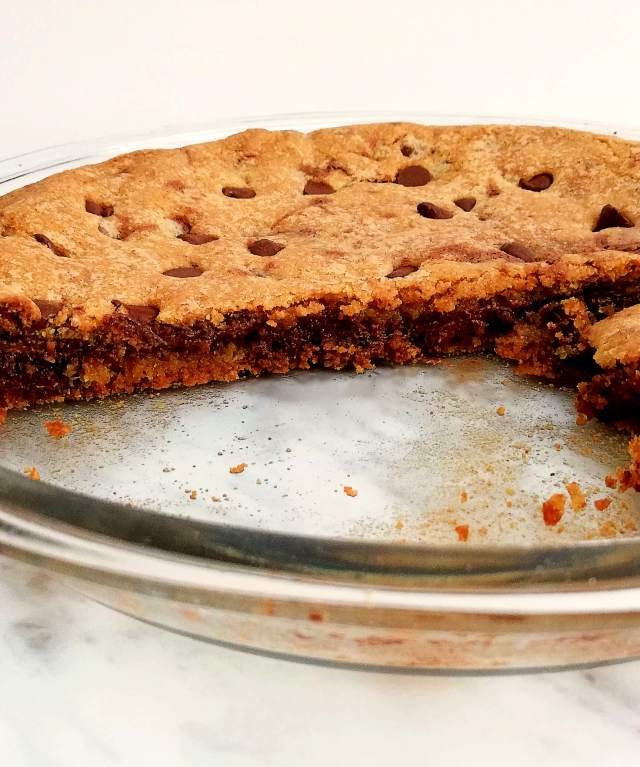 giant Nutella stuffed chocolate chip cookie sliced in pie dish
