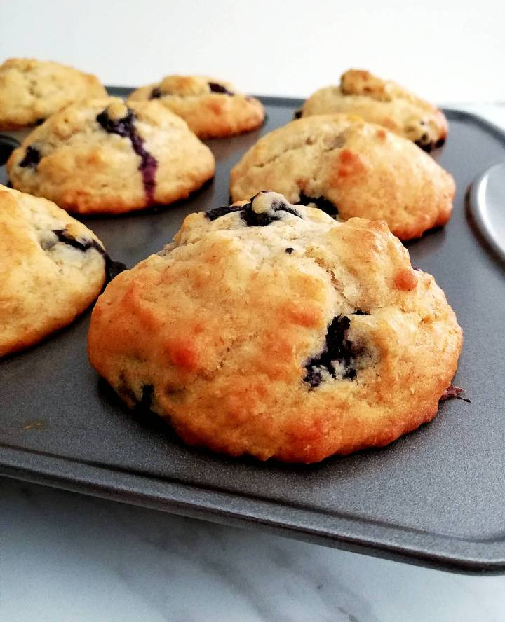 healthy blueberry banana muffins in muffin tin close up (1)