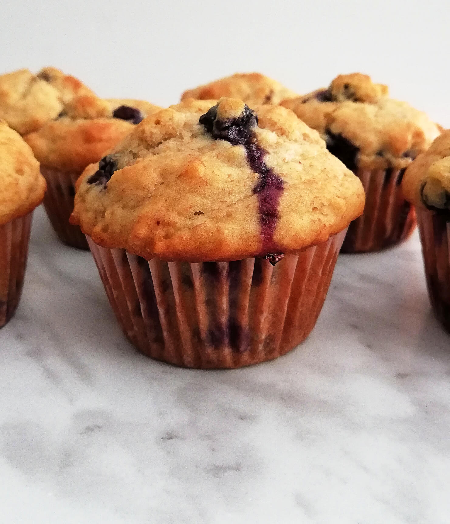 healthy blueberry banana muffins lined up