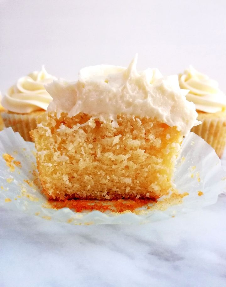 sour cream vanilla cupcakes cut in half head on view