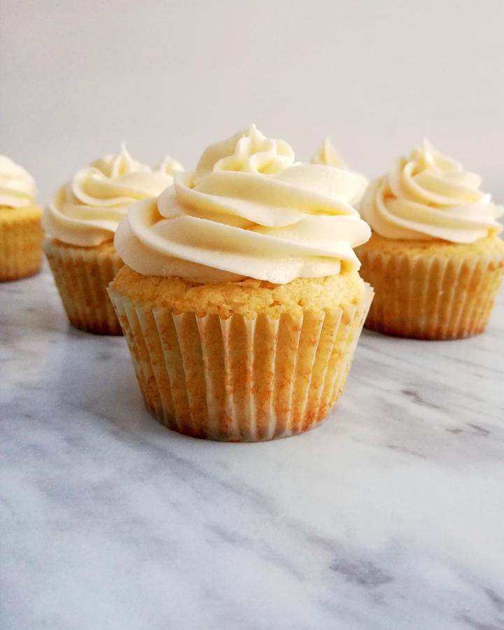 sour cream vanilla cupcakes frosted head on view
