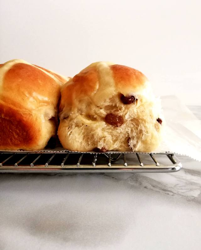 Easter hot cross buns baked and glazed side view