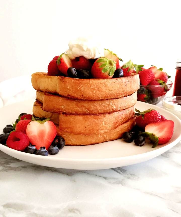 French toast topped with fruits and whipped cream