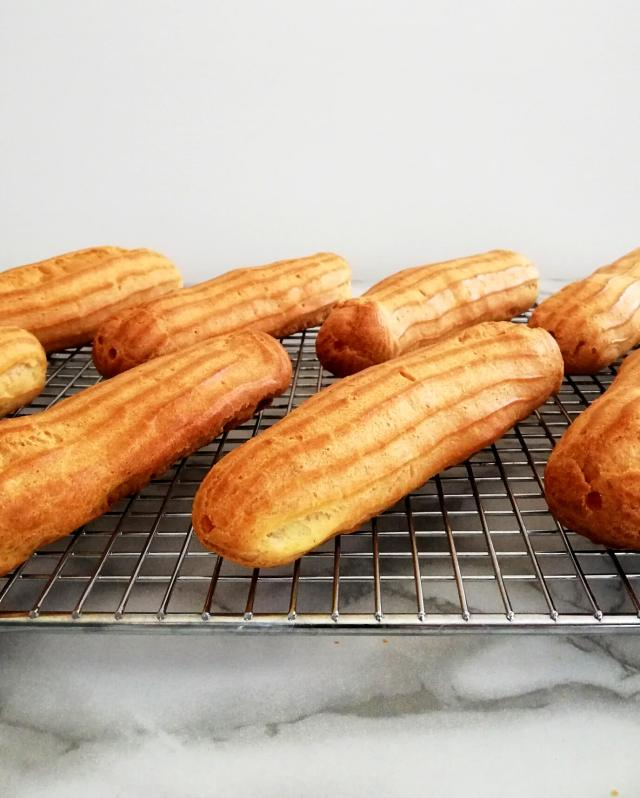 éclair shells baked and on cooling rack