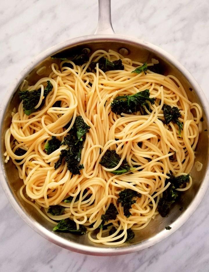 spicy kale pasta in skillet overhead
