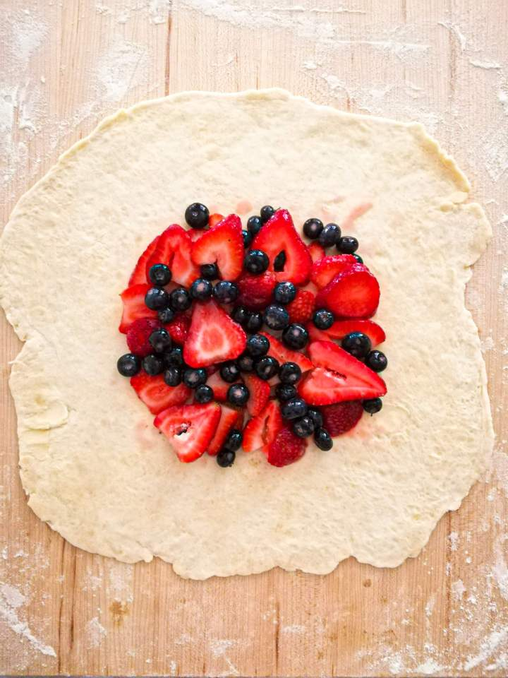 mixed berry galette filling placed in middle of dough