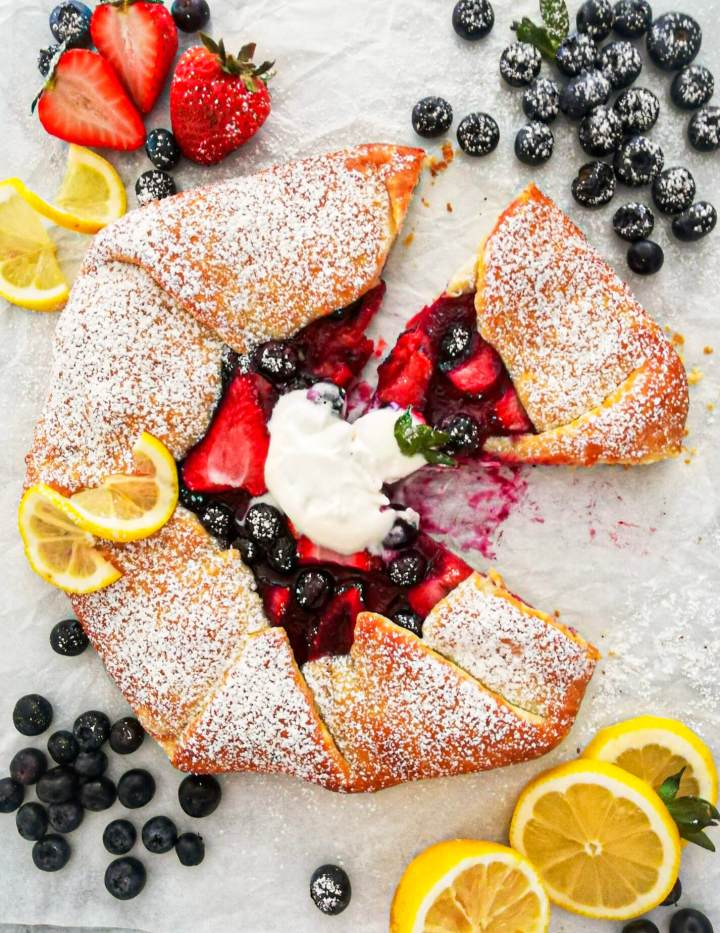 mixed berry galette sliced with 1 slice missing
