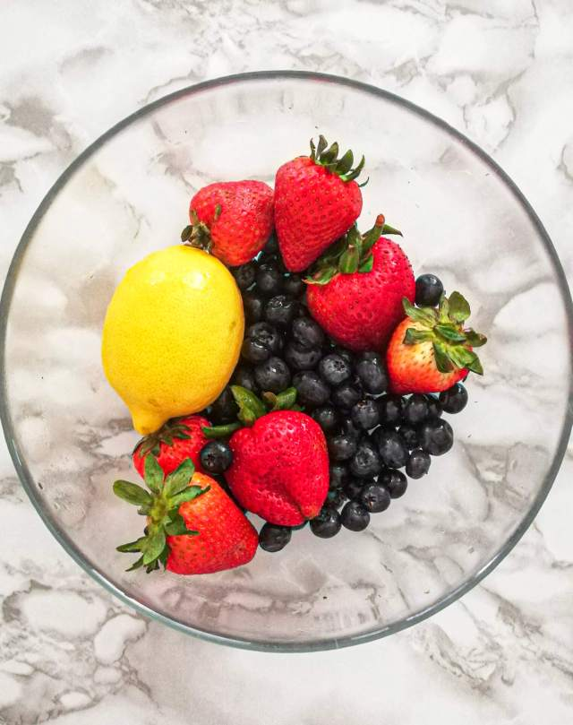 mixed berry galette strawberries, blueberries and lemon in bowl