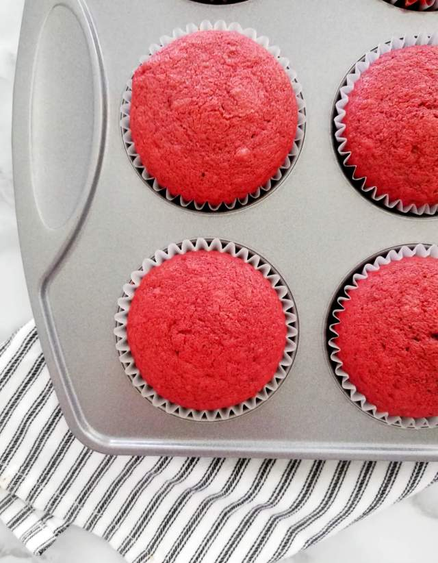 red velvet cupcakes baked in cupcake tin close up of one
