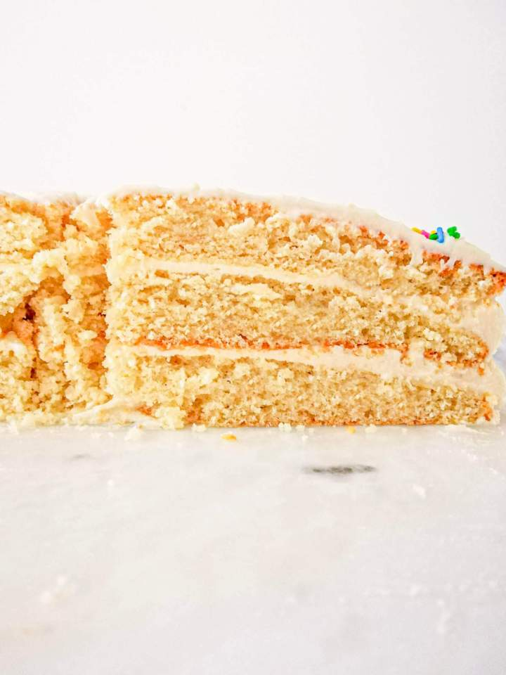 vanilla birthday cake without a cake pan sliced side view of cake (1)