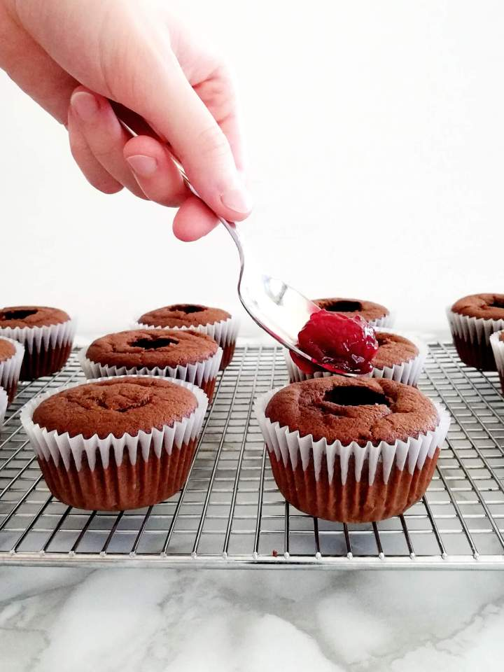 black forest cupcakes filling centers with cherry filling