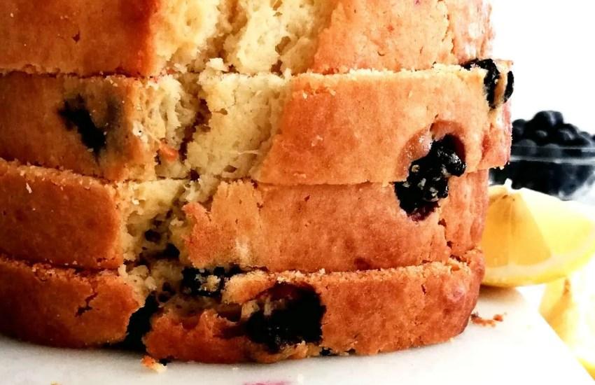 lemon blueberry quick bread sliced stacked