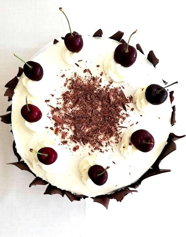 black forest cake on cake platter overhead image