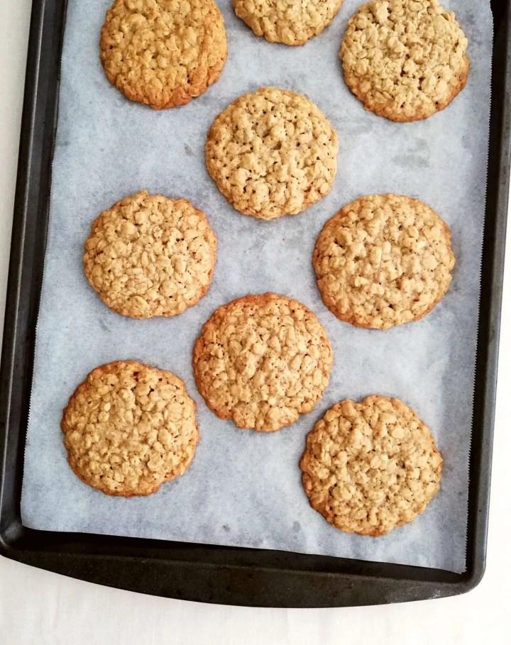 baked oatmeal cookies on baking sheet overhead image