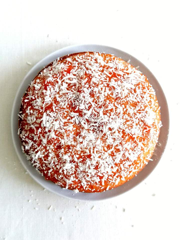 coconut jam cake on plate overhead image