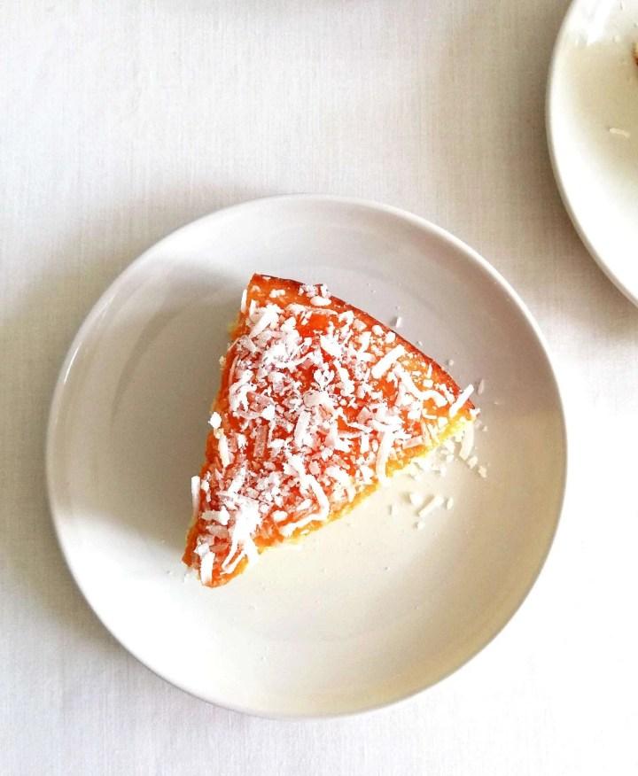 coconut jam cake slice in plate overhead image