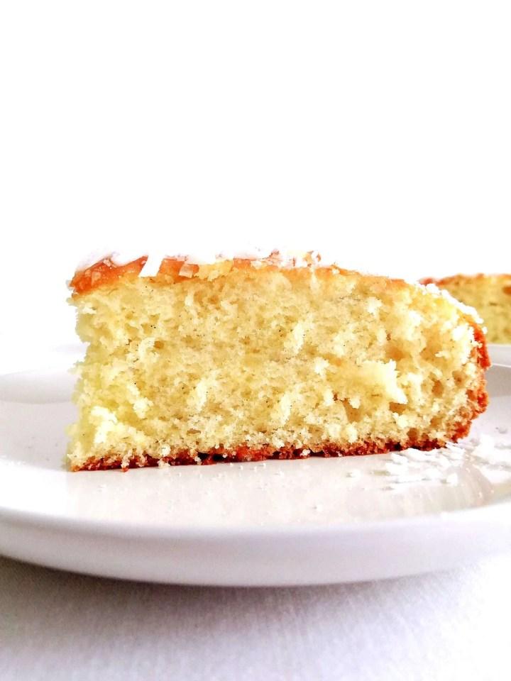 coconut jam cake slice in plate side view