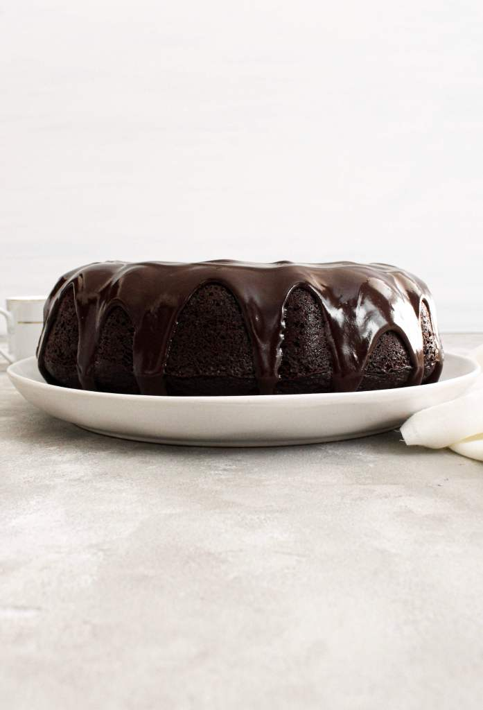 chocolate bundt cake topped with chocolate ganache head on view