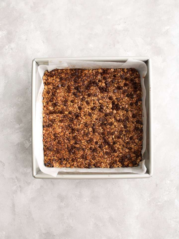 chocolate chip oat bars in square pan topped with chocolate chips overhead