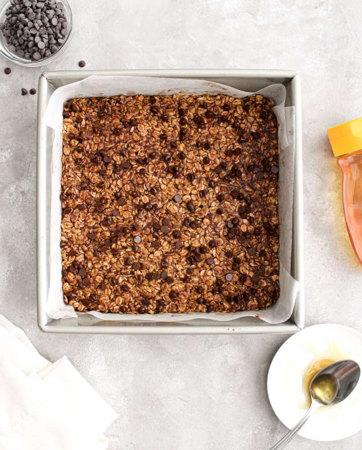 chocolate chip oat bars in square pan overhead