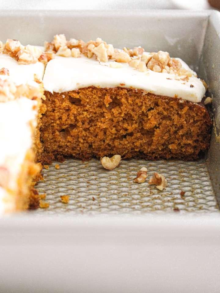 pumpkin sheet cake sliced in baking pan side view of texture