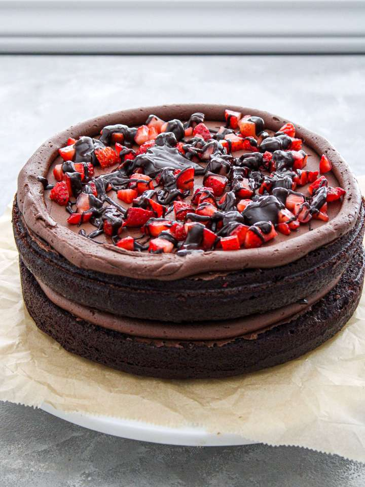 chocolate covered strawberry cake filled with strawberries and chocolate